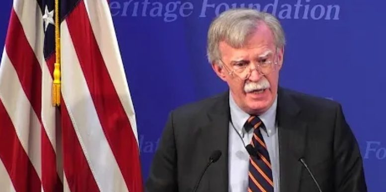 Bolton speaks at Heritage Foundation. Photo credit to The Freedom Times compilation with The Heritage Foundation Screen Shot.